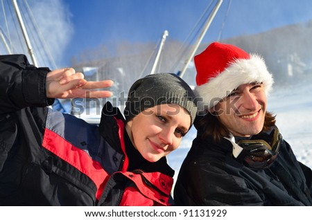 two skiers resting - stock photo