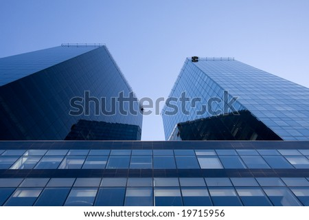 Two skyscrapers and blue sky - stock photo