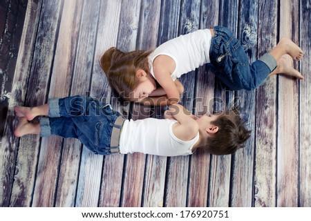 Two sleeping kids in studio  - stock photo