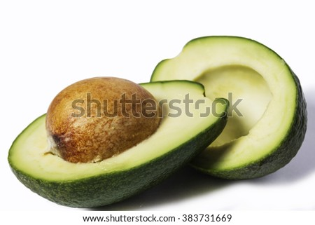 Two slices of avocado isolated on a white background. One slice with core. Design element for product label, catalog print, web use.
