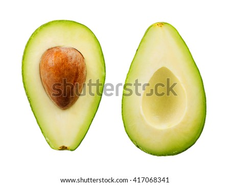 Two slices of avocado isolated on the white background. One slice with core. - stock photo