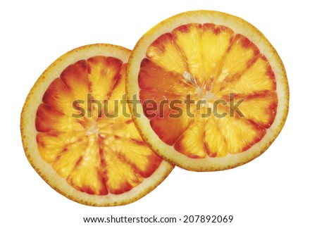 Two slices of blood orange, elevated view, close-up - stock photo
