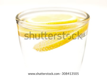 Two slices of lemon in sparkling water - stock photo