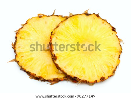 two slices of pineapple isolated on white background - stock photo