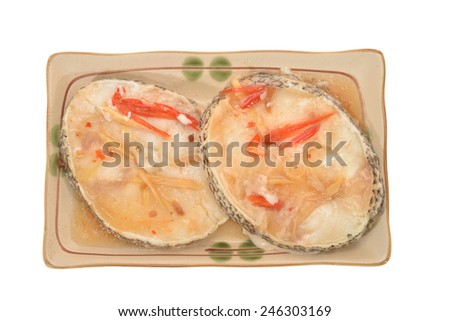 Two Slices Of Steam Fish with Ginger and Chili Sauce - stock photo