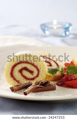 Two slices of strawberry jam Swiss roll - stock photo