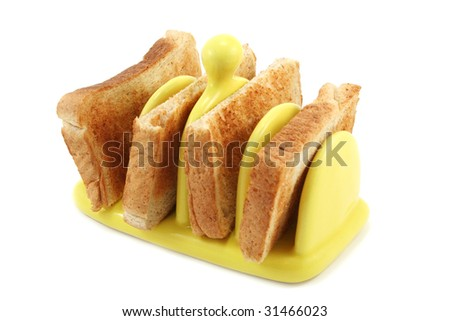 Two slices of toast cut into four placed in a yellow ceramic toast rack - stock photo