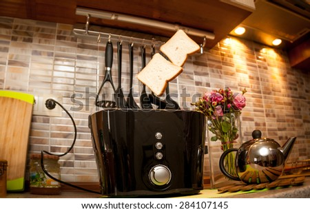 Two slices of toasted bread popping up of toaster - stock photo