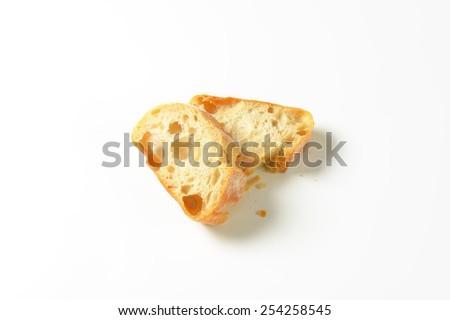 two slices of white bread on white background - stock photo
