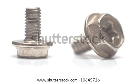 Two small bolts on the white. Macro. Shallow DOF. - stock photo
