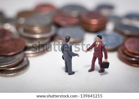Two small business men making a deal - stock photo