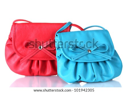 Two small colorful handbags isolated on white