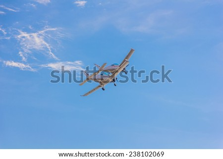 Two small flying aircraft in a blue sky