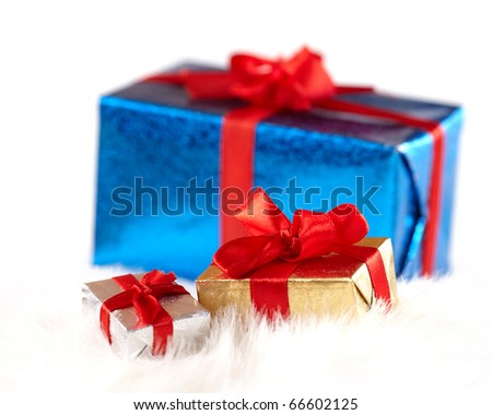 Two small gift boxes over the big one isolated on white - stock photo