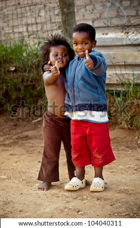 Two small kiddies �hey hey, everything is ok. - stock photo
