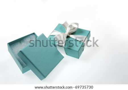 two small turquoise box tied with a white ribbon - stock photo