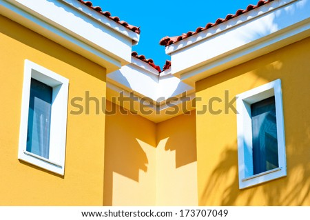 two small windows in the attic under the roof - stock photo