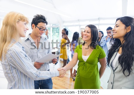 Two Smart-Casual Women Having a Handshake - stock photo