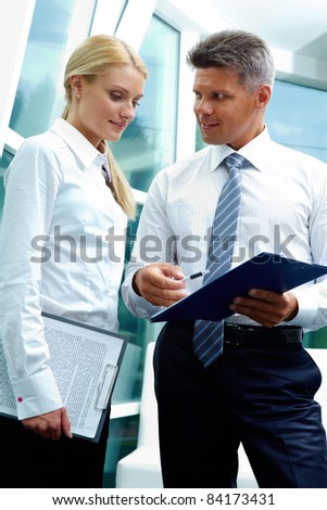 Two smart employees discussing new strategy at meeting