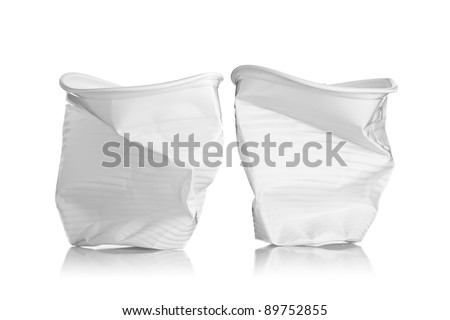 two smashed plastic cups, isolated on white background - stock photo