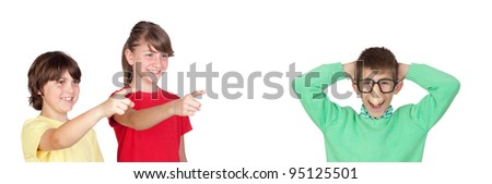 Two smiled children pointing a funny boy isolated on white background - stock photo
