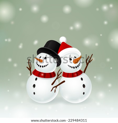 Two smiley snowman on dark background and snow - stock photo