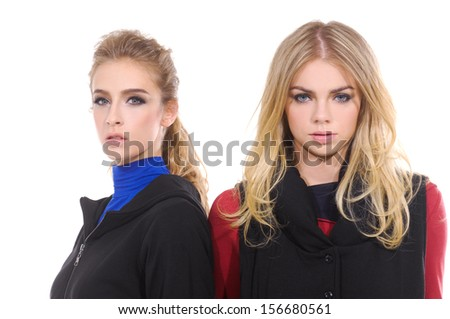 Two smiling attractive girl friends - stock photo