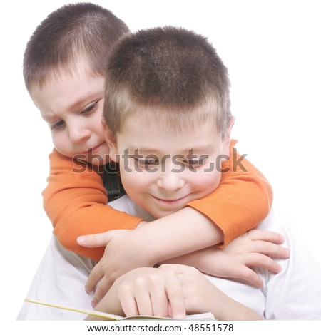 Two smiling brothers reading book photo against white background