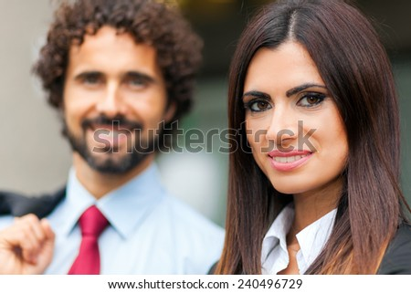 Two smiling business people outdoor