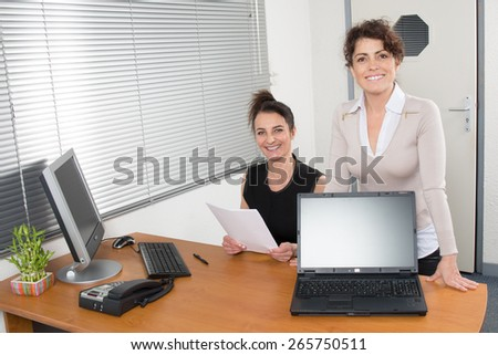 Two Smiling business woman. In a modern office.