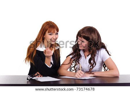 two smiling businesswomen isolated on white