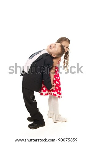 Two smiling children girl and boy in colorful clothes - stock photo