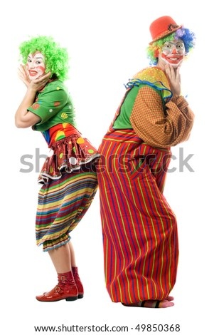 Two smiling clowns are back to back. Isolated - stock photo