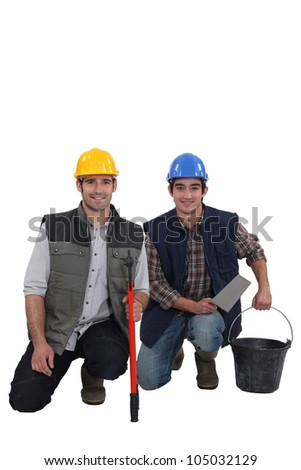 Two smiling construction workers - stock photo