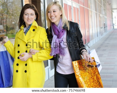 Two smiling friends out shopping