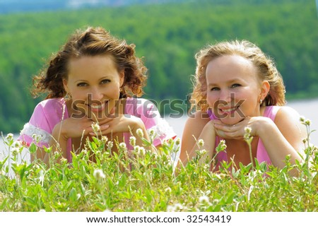 Two smiling girls - stock photo