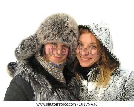 Two smiling girls on snowy background - stock photo