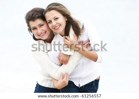 two smiling girls over white