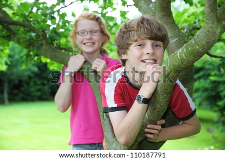 Two smiling kids in the garden