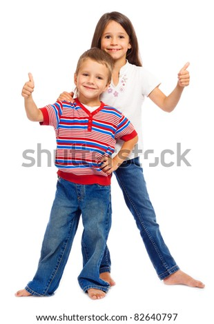 Two smiling little children with thumbs up sign, isolated on white - stock photo