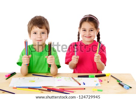Two smiling little kids at the table with color pencils, isolated on white - stock photo