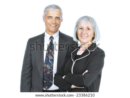 Two Smiling Mature Business People isolated over white