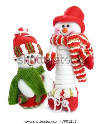 Two smiling snow man in the red caps and scarfs