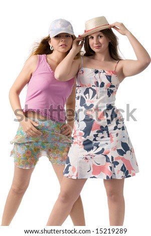 two smiling women in summer dresses isolated on white