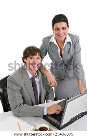 Two Smiling Young Businesspeople Working in Office - stock photo