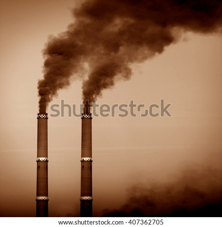 Two smoke stacks, sepia