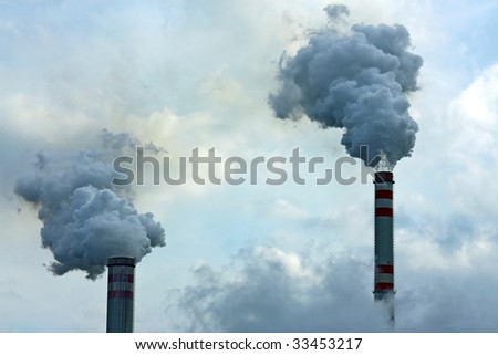 two smoking chimneys - stock photo