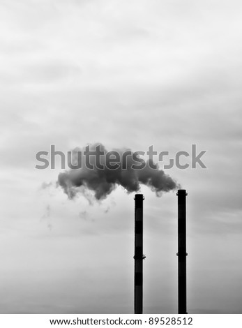 Two smoking chimneys / black and white / - stock photo
