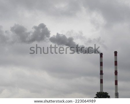 Two smoking chimneys pollution air - stock photo