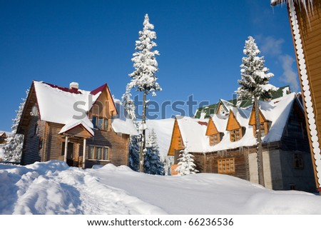 Two snow-covered wooden at home in Carpathian Mountains, Ukraine, Dragobrat - stock photo